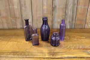 Assorted Purple Bottles-S Vintique Rental WI