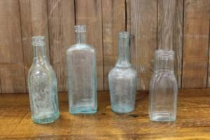 Assorted Sea Green Bottles-M Vintique Rental WI