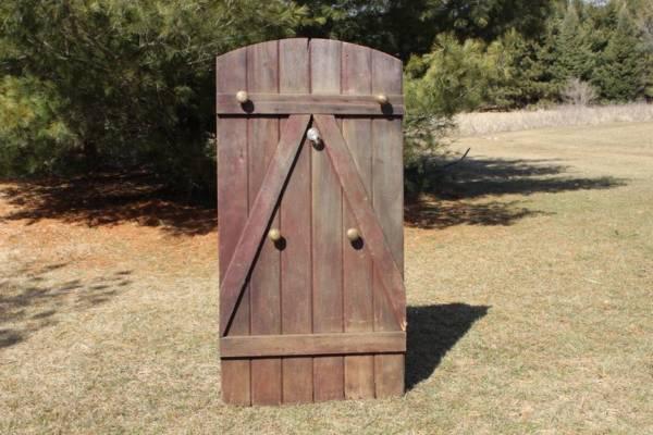 Worn Red Door with Door Knobs